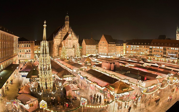 NUREMBERG, GERMANY - NOVEMBER 28: A general view of the market place with the Frauenkirche in the background prior to the opening ceremony of the Christmas Market on November 28, 2008 in Nuremberg, Germany. Germany's traditional christmas markets draw millions of visitors from all over the world. The market is open from November 28 to December 24 at 12 noon. (Photo by Thomas Langer/Getty Images)