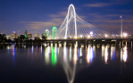 The downtown Dallas skyline and the Margaret Hunt Hill Bridge rise over the Trinity River, which was close to 40 feet, the level defined as ìmajorî flood stage, on Sunday evening, May 24, 2015. The last time the Trinity River rose to 40 feet was June 28, 2007, when it crested at 40.25 feet. (Smiley N. Pool/The Dallas Morning News)